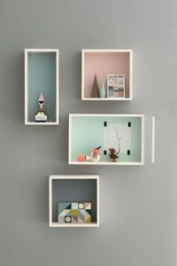 Pastel boxes hanging on the wall