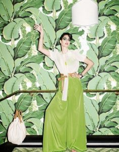 lady in front of fern wallpaper inspiration