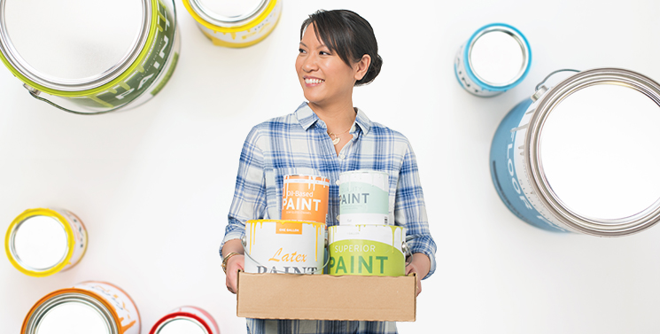 woman with recycled paint cans