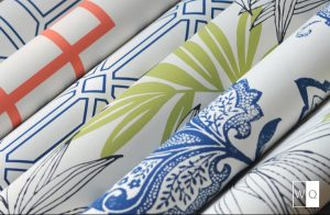 brightly colored rolls of wallpaper