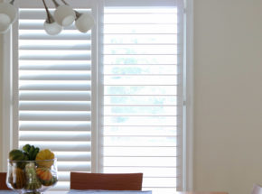 Graber shutters in dining room. One open one closed