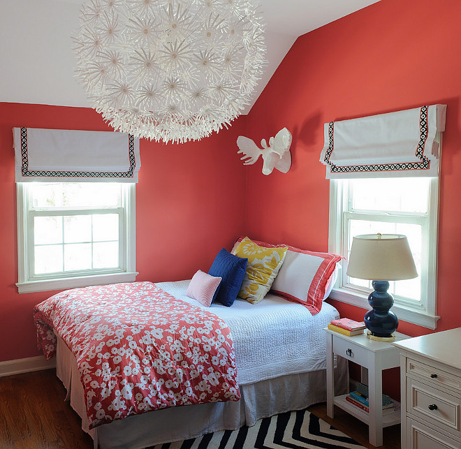 Coral walls in girl's bedroom